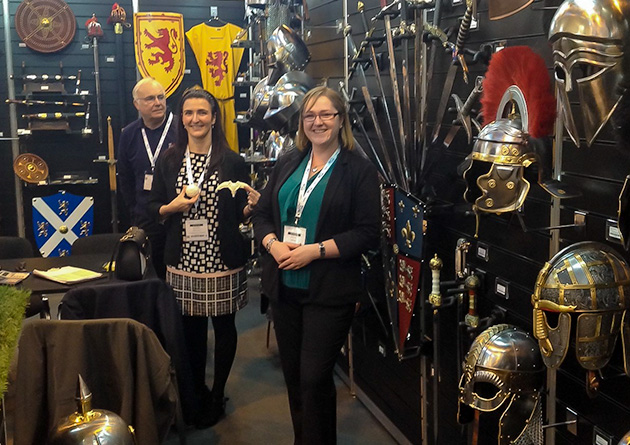 The Knight Shop Trade at  the NEC Spring Fair - staff manning the stand by the medieval swords display